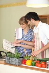 Couple following a recipe book