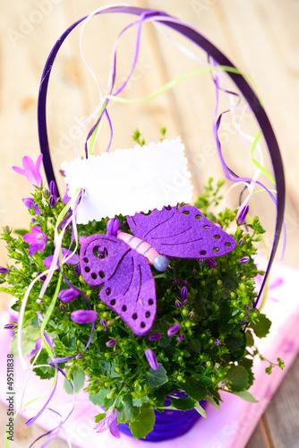Blumentopf mit Textschild