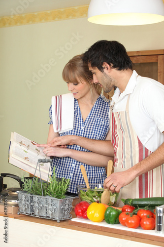 Couple following a recipe book