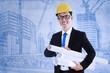 Architect holds blueprint plans
