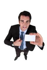 Man presenting business card