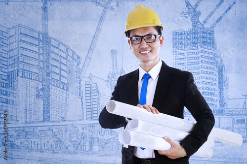 Architect holds blueprint plans