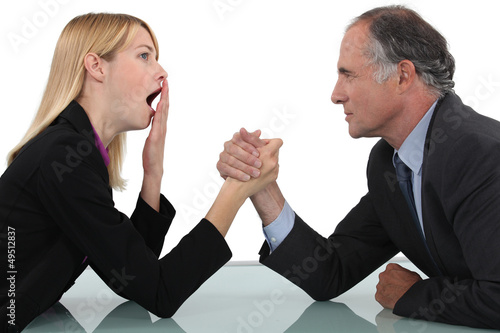 Woman arm wrestling with her boss