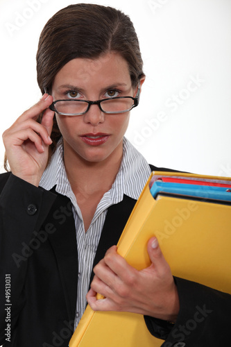 brilliant female executive holding files