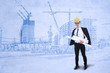 Engineer holds blueprints