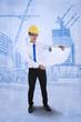 Engineer reviews blueprint plan