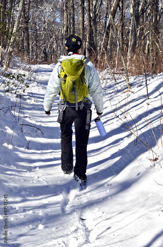 Girl Hiking in Winter Snow