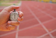 Old stopwatch in a hand in a running track