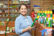 mature  woman chooses fertilizers at store