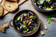 Closeup of mussels served with bread in a country way