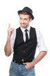 Smiley young casual man in hat gesturing attention forefinger. I