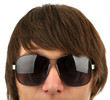 Head of the young man in sunglasses