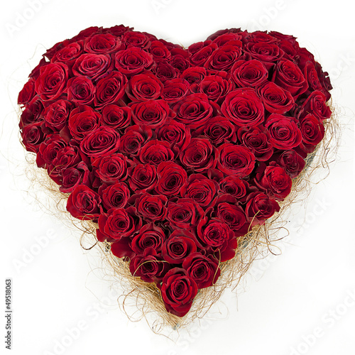 Poster composition of red roses in the shape of heart isolated on white