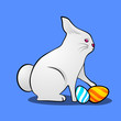 Little cute Easter rabbit with painted eggs on blue background.