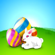 Little cute Easter rabbit with painted eggs on nature background