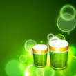 Saint Patrick's Day shiny green background with beer mugs.
