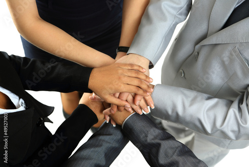 Image of business partners hands on top of each