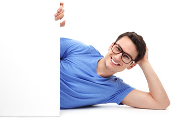Man lying down with blank poster