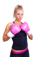 beautiful boxing girl wearing pink gloves - isolated