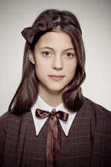 teen school girl wearing old style formal clothes - sepia