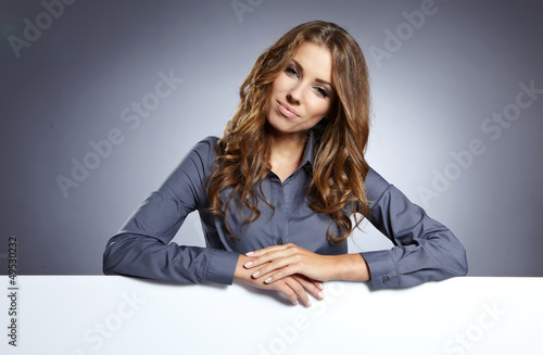 Business woman white isolated portrait, hold blank card.
