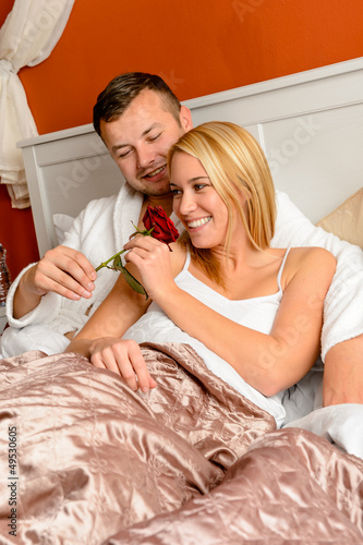 Couple bed smelling rose romantic Valentine's day