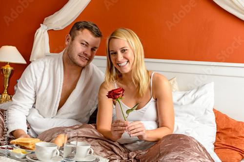 Smiling couple bed breakfast celebrating Valentine's