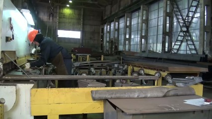close-up of the machine that bends the metal plate at the factor