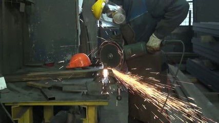 man in a mask metallic profile circular saw cuts