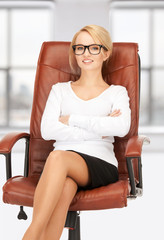 young businesswoman sitting in chair