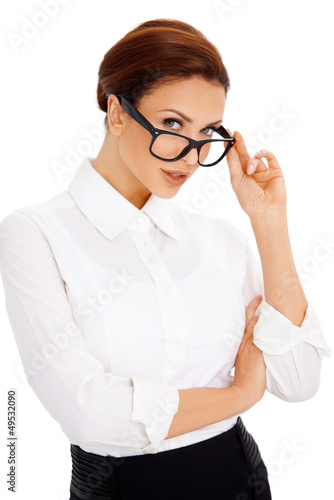 Woman peering over her glasses