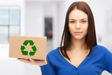 attractive businesswoman with recyclable box