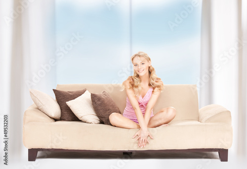 happy woman on sofa