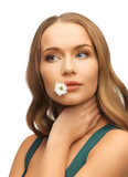 woman with camomile in mouth