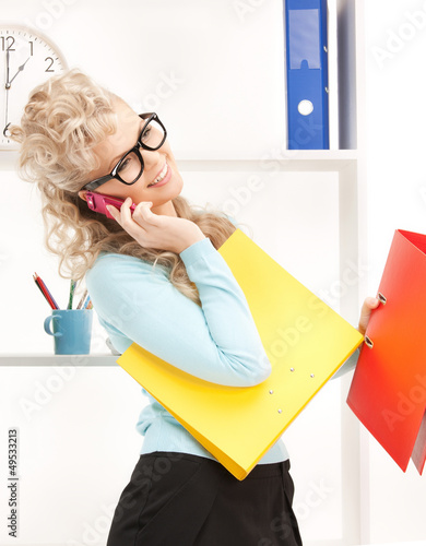 woman with folders and cell phone