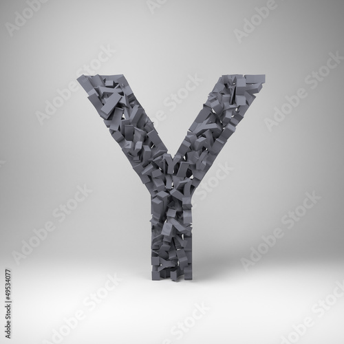 Letter Y made out of scrambled small letters in studio setting