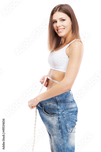 Beautiful slim woman on white background