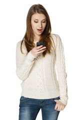 Surprised youn woman reading a sms on cell phone