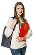 Young woman wearing backpack and holding notebooks
