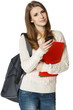 Woman student with backpack and books dialing cell phone