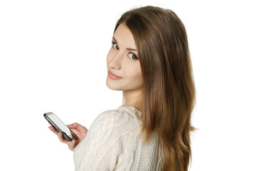 Closeup of young woman with mobile phone