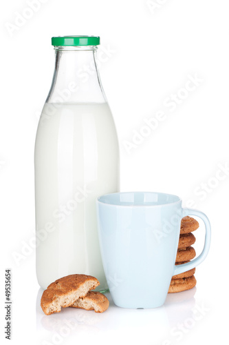 Cup, bottle of milk and cookies