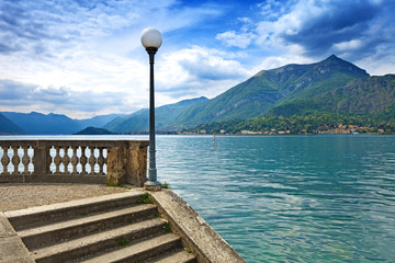 Como Lake landscape. Lamp, stairs and water. Bellagio Italy