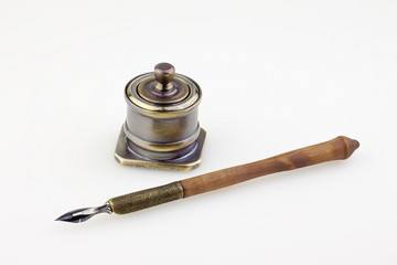 antique  ink pen  and inkwell isolated