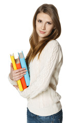Relaxed woman holding books