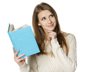 Smiling woman holding book and looking at copy space