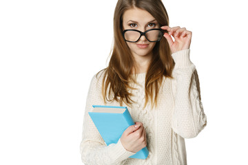 Stern young woman looking over top of eyeglasses