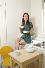 Young lady enjoys a cuppa