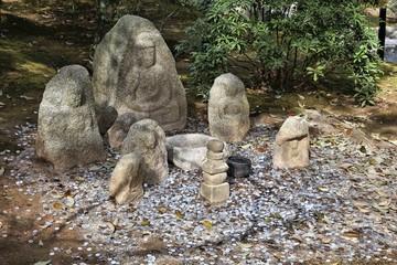 Jizo statues in Kyoto - Kinkakuji temple in Japan