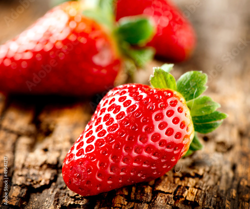 Strawberry over Wooden Background. Strawberries close-up
